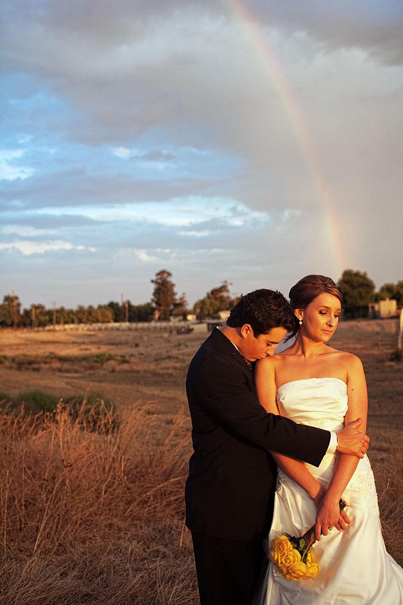 Rainbow sunset wedding portrait by Heather Elizabeth Photography