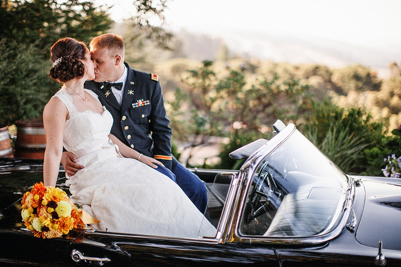 Romantic wedding portrait in a classic Ford Thunderbird at the Thomas Fogarty Winery