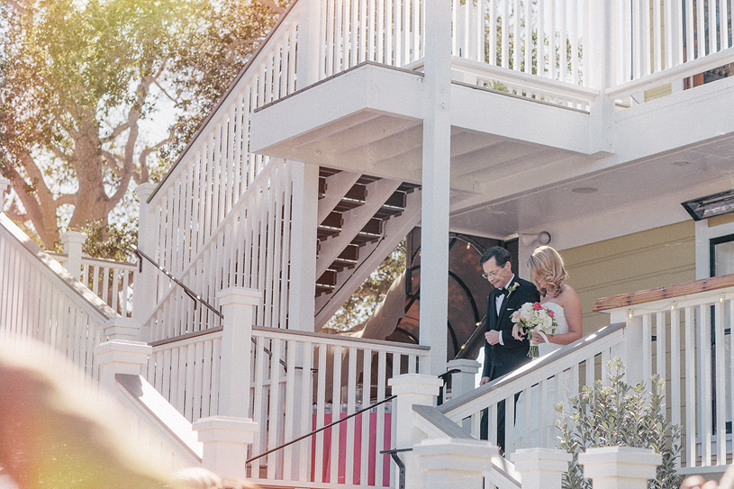 Father walking his daughter down the aisle at her wedding at the Perry House in Carmel