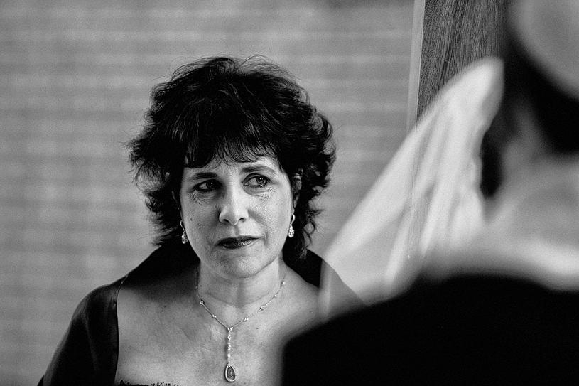 Mother watching her daughter exchange vows at her San Jose Wedding