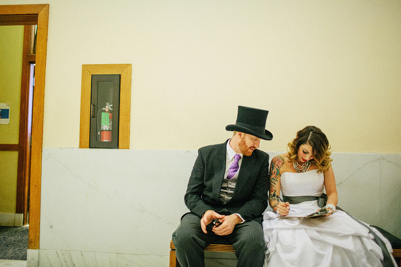 Alternative tattooed wedding couple at City Hall for their elopement