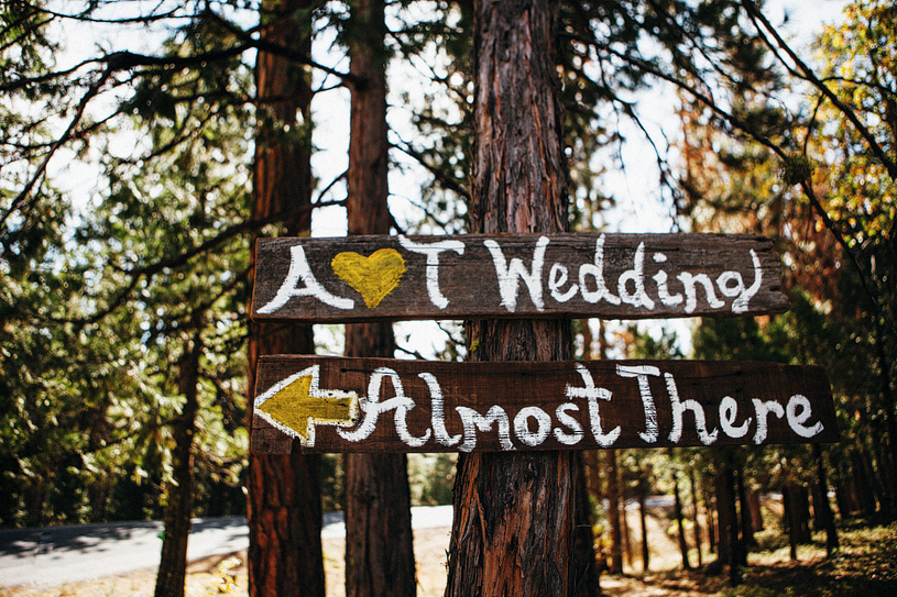 Hand made DIY Wedding sign pointing to the Evergreen Lodge in Yosemite