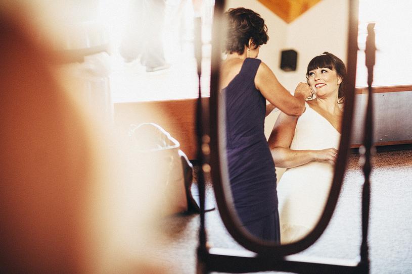 Bride's mother adjusting her wedding gown in Yosemite
