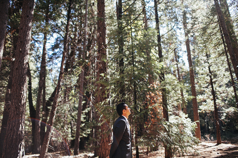 Groom waiting for his first look at the Evergreen Lodge in Yosemite