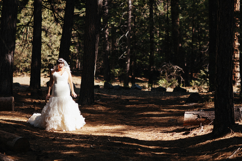 Adorable photo of a bride excited to see her groom during their first look at the Evergreen Lodge in Yosemite