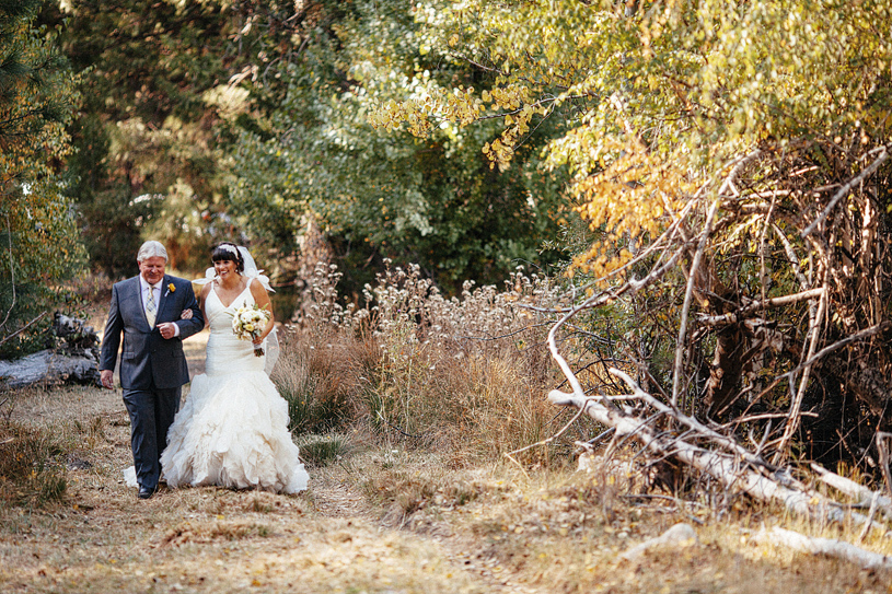 Father walking his daughter down the aisle at a wedding in Yosemite, California