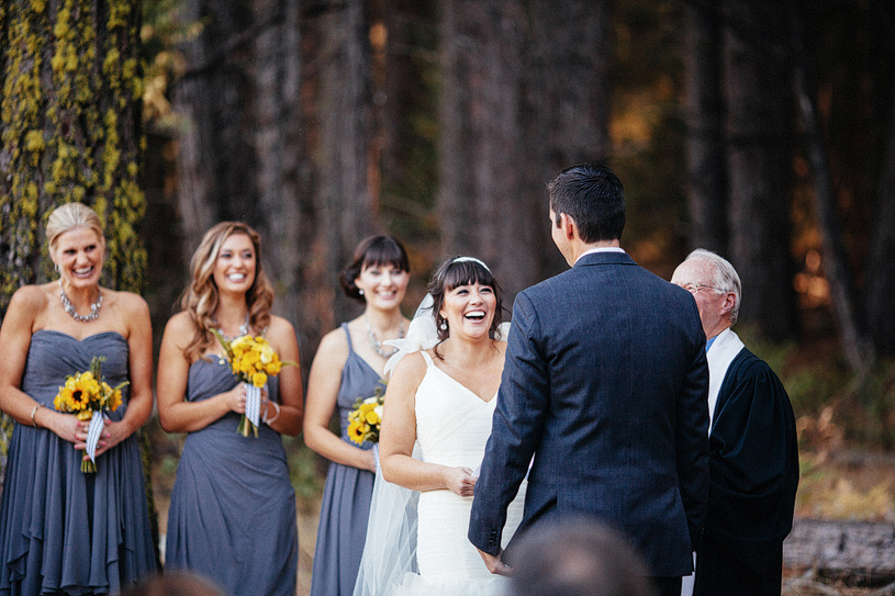 Bride laughing during her wedding ceremony in Yosemite