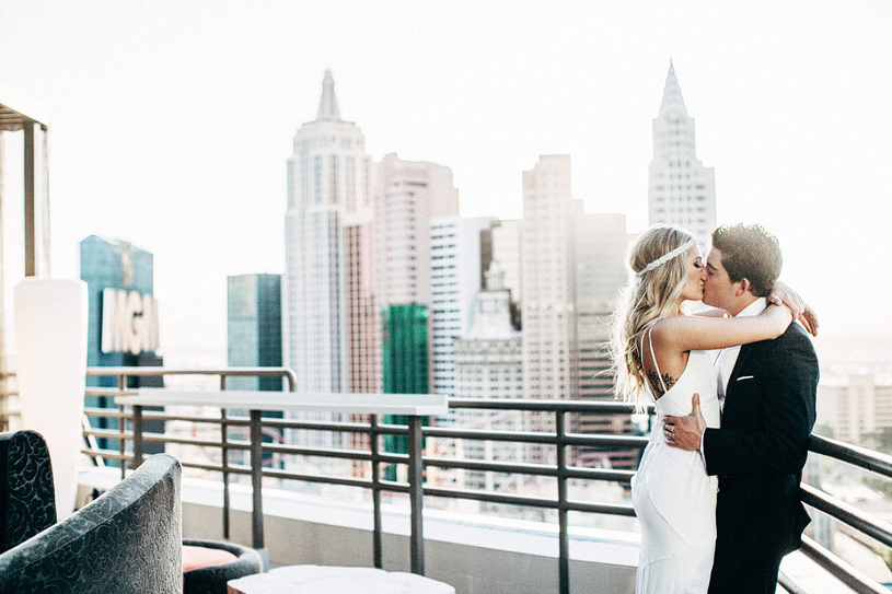 Romantic wedding photograph on the balcony of the pent house suite at the mgm grand