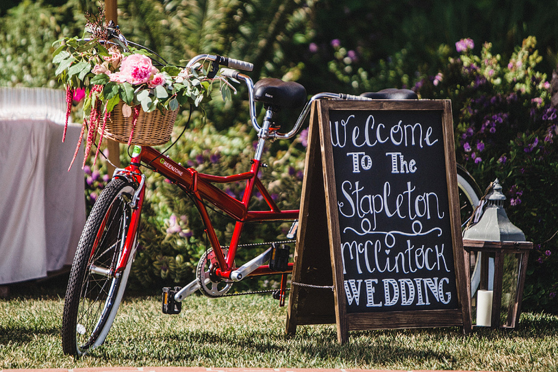 Adorable chalk board signage at a wedding at the Four Seasons Santa Barbara