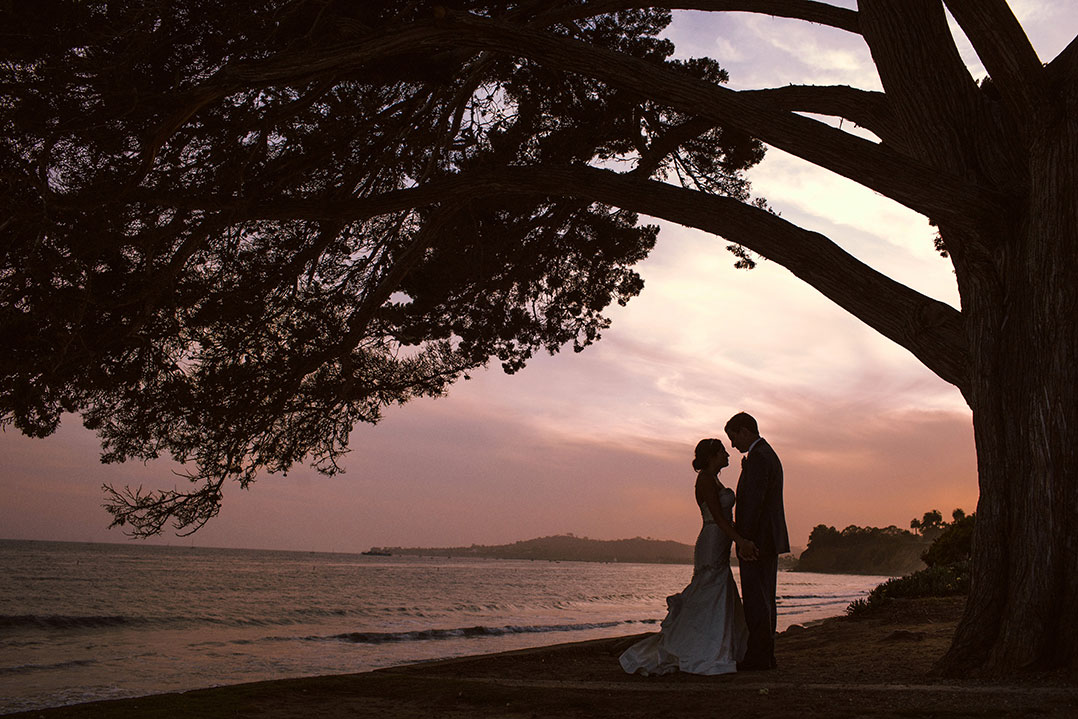 A romantic sunset wedding portrait taken at the Four Seasons in Santa Barbara by Heather Elizabeth Photography
