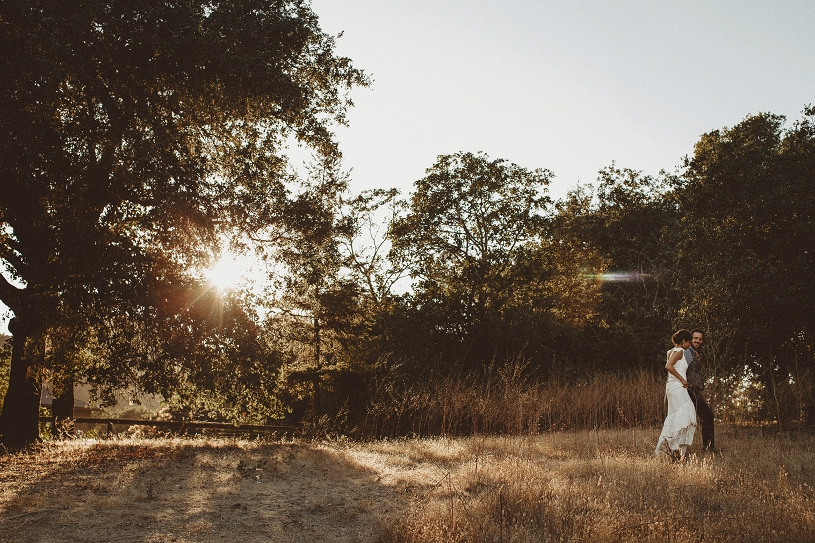 Beautiful environmental portrait of a bride and groom at their wedding in Healdsburg