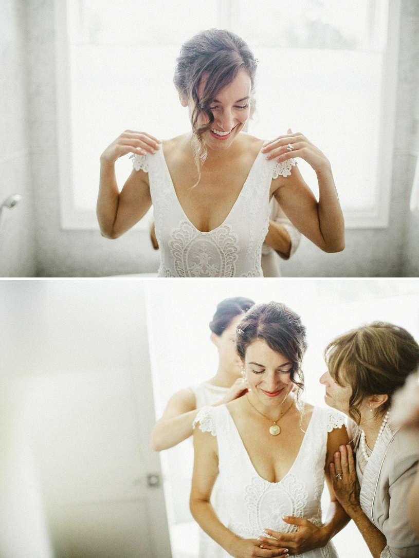 mother of bride helping her prepare for her wedding