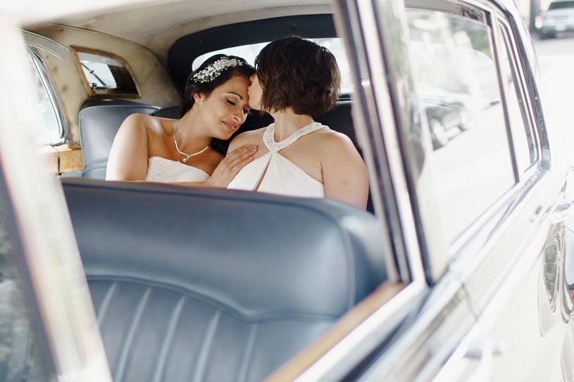 Lesbian wedding portrait inside a Roles Royce