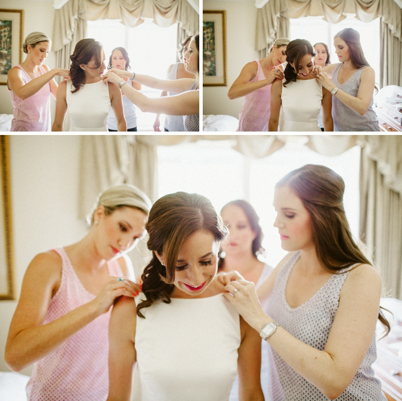 bridesmaids dressing the bride at the layfayette park hotel
