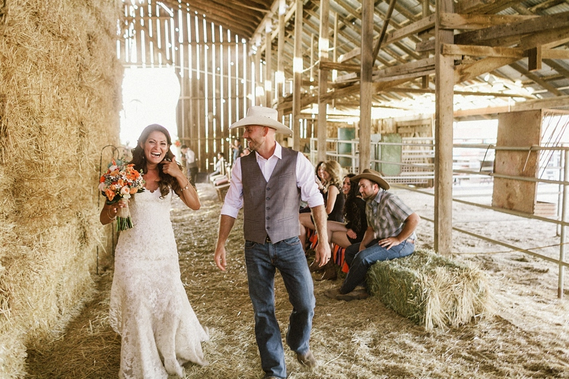 bride and groom dancing as they leave their barn ceremony by heather elizabeth photography