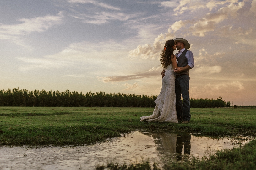 sunset wedding portraits at a farm yard wedding by heather elizabeth photography