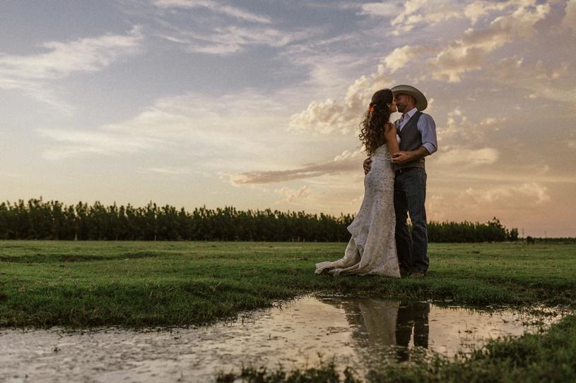 sunset wedding portraits at a farm yard wedding by heather elizabeth photography