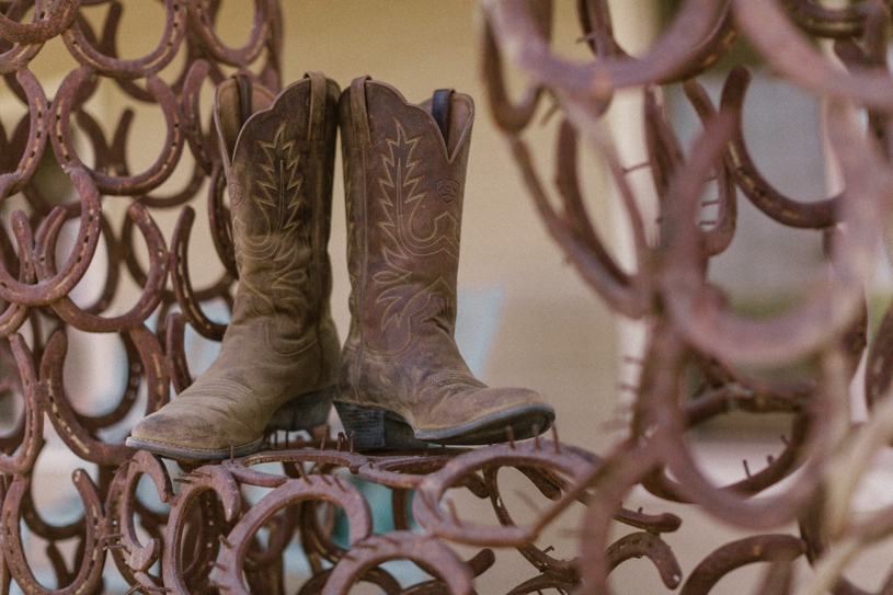 cowboy boots for a bride's wedding shoes at her farmhouse wedding by heather elizabeth photography