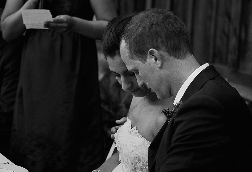 emotional bride and groom crying during wedding speeches at the holman ranch in carmel california by heather elizabeth photography