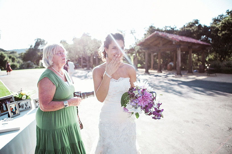 bride gets emotional when seeing her grandparents at her Holman Ranch wedding in carmel california by heather elizabeth photography