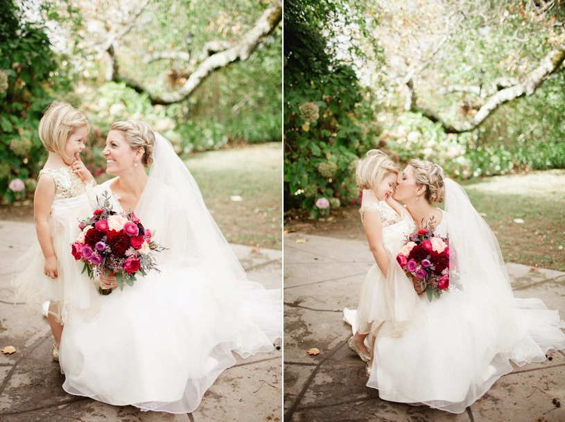 bride and her flower girl sharing a moment wearing haley paige at the vine hill house by heather elizabeth photography