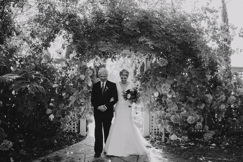 bride and her dad walking to her ceremony at the vine hill house by heather elizabeth photography
