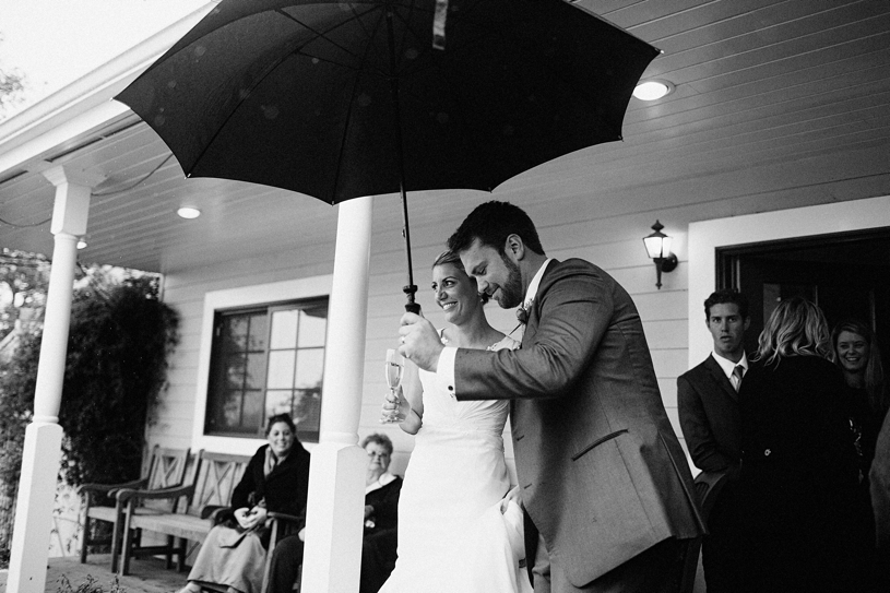 rainy day wedding photo by heather elizabeth photography at the vine hill house