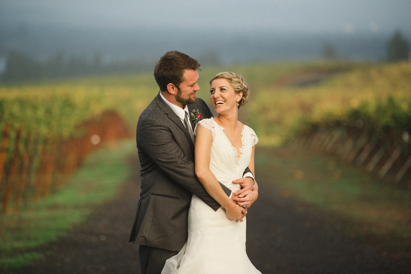 sweet candid wedding portrait of a couple in the vineyard of the vine hill house by heather elizabeth photography
