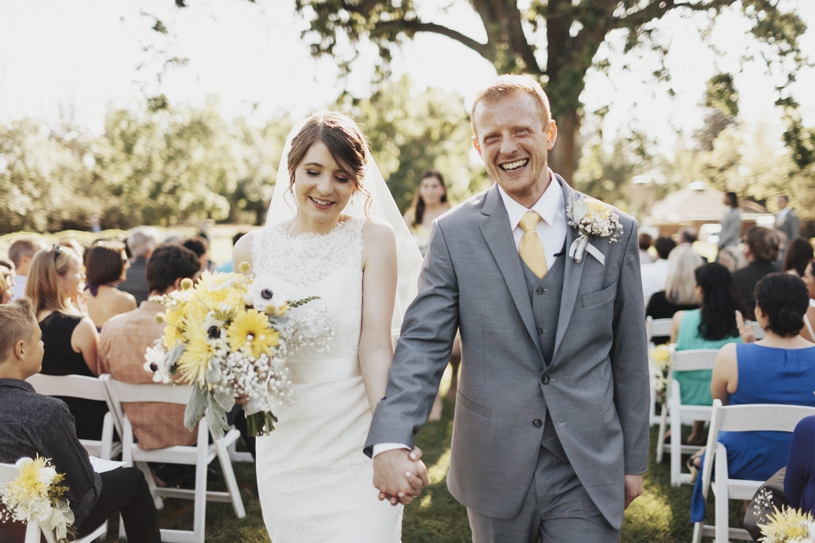 bride and groom leaving wedding wearing mikaella from canada and 9 tailors from boston by heather elizabeth photography