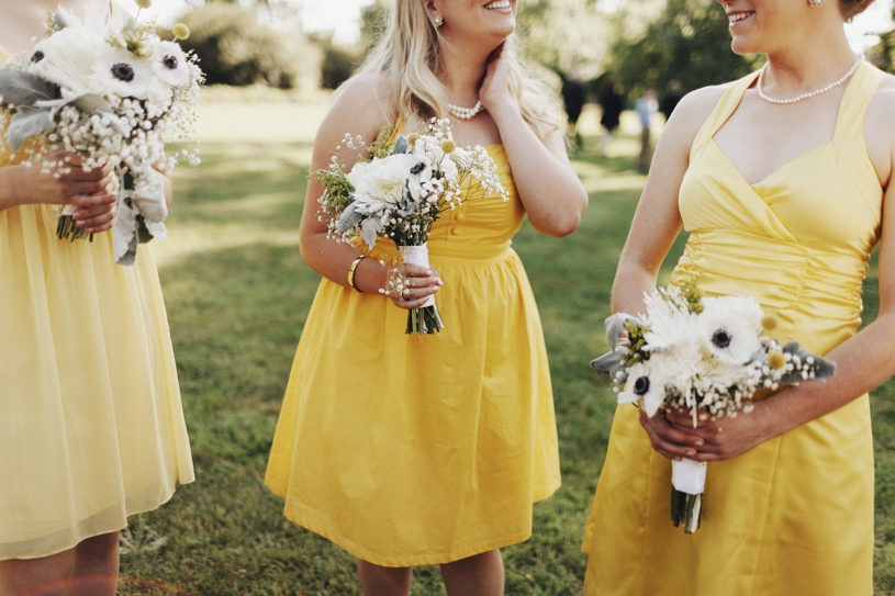 yellow bridesmaids dresses for the spring by heather elizabeth photography