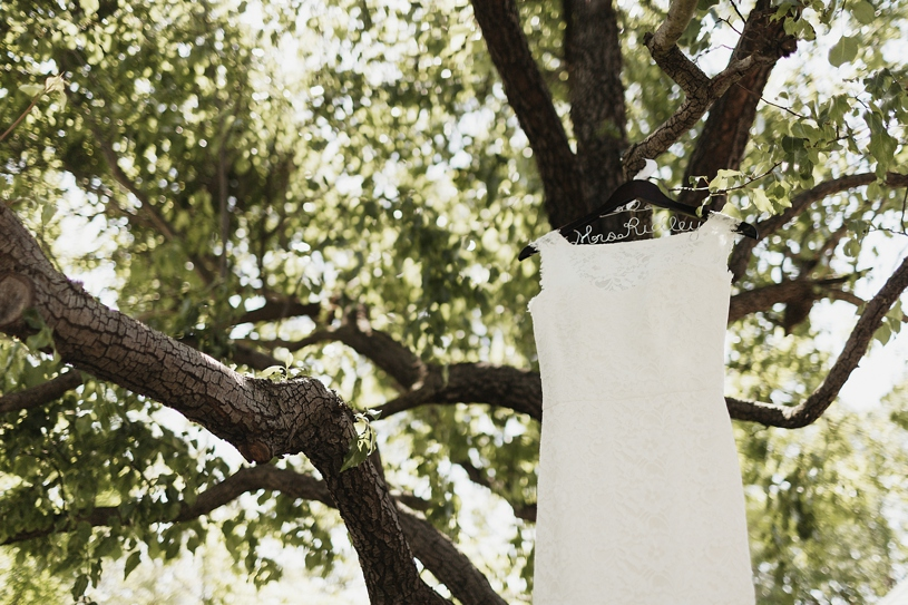 Mikaella wedding gown hanging up in a tree for a wedding at UC Davis by Heather Elizabeth Photography