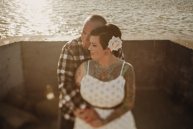 a tattooed couple engagement session photographed with a canon tilt shift lens by heather elizabeth photography in benicia california