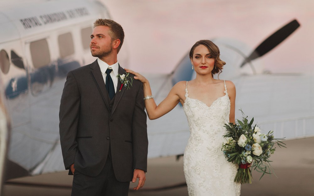 Aviation themed wedding with a la soie bridal gown by Heather Elizabeth Photography