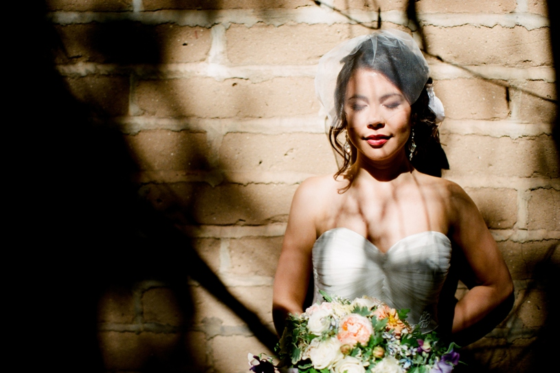 Bride wearing a Lea-Ann Belter gown at her wedding at the Holly Farm in Carmel California by Heather Elizabeth Photography