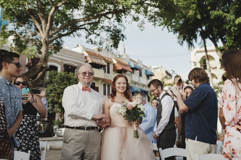 Bride walking down the aisle at her wedding ceremony at Plazuela le Rogativa in Old San Juan Puerto Rico by Heather ELizabeth Photography