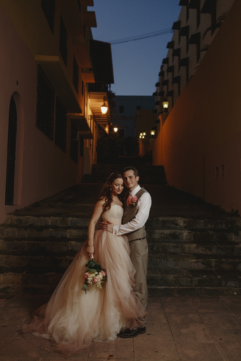Bride and groom at their wedding wearing vera wang white at Hotel El Convento in Old San Juan by Heather Elizabeth Photography