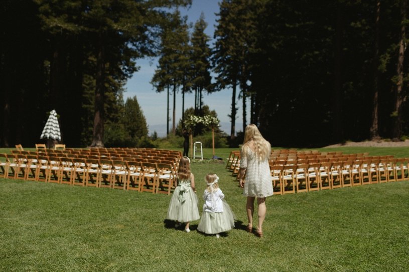 flower girls watching a wedding being prepared at the mountain terrace in woodside california by heather elizabeth photography