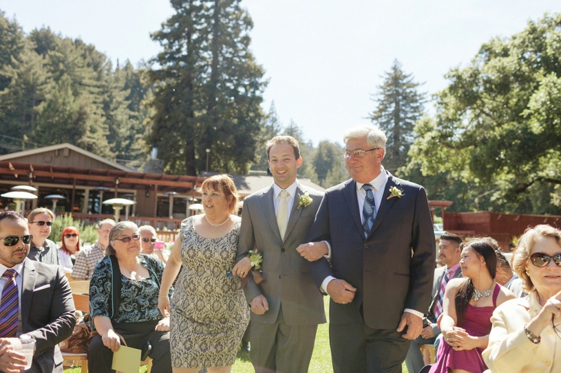 Groom walking down the aisle with both of his parents at a gay wedding in Woodside California by Heather Elizabeth Photography