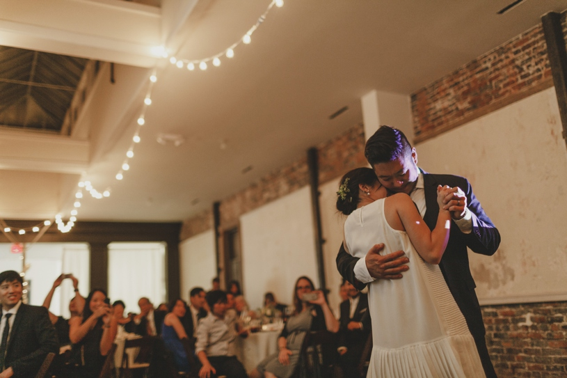 romantic first dance between bride and groom by heather elizabeth photography at firehouse 8 in san francisco