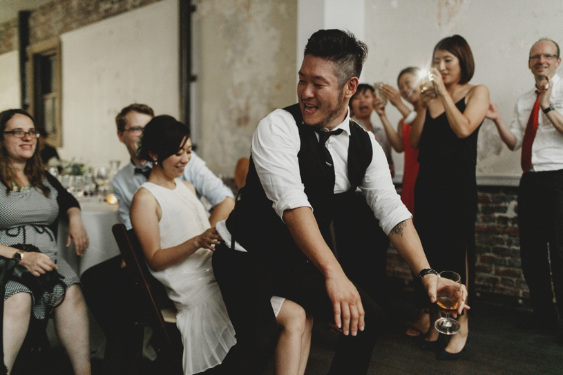 hilarious wedding photography at a wedding at firehouse 8 by heather elizabeth photography