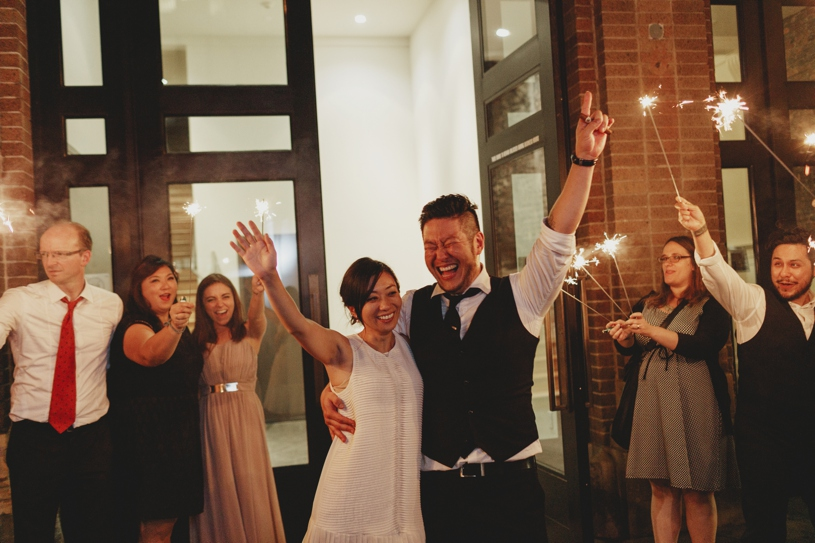 sparkler exit after a wedding in front of firehouse 8 in san francisco by heather elizabeth photography