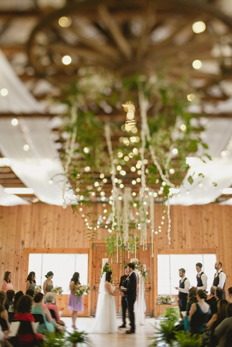 Organic free lush floral arrangement at a Christian wedding at the WIlliams Barn in San Marcos by Heather Elizabeth Photography