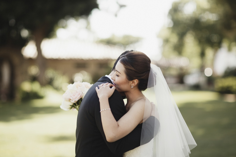 sweet moment during a first look at a wedding at the adobo lodge in santa clara by Heather Elizabeth Photography