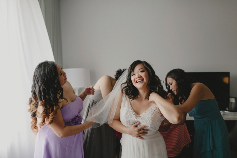 bride getting ready for her san diego wedding at the Lakehouse Hotel and Resort in San Maros by Heather Elizabeth Photography