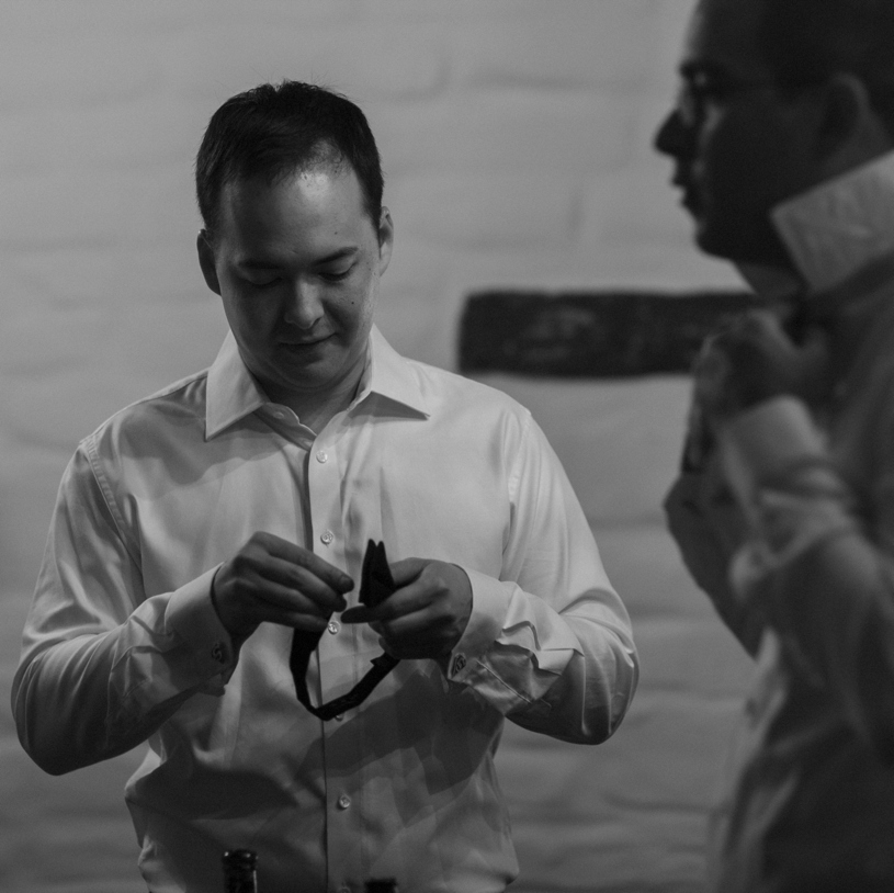 Groomsmen preparing for a wedding at the Adobo Lodge by Heather Elizabeth Photography