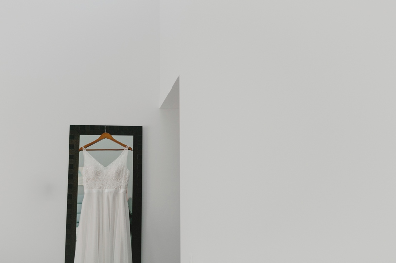 Wedding gown hanging up at the Lakehouse Hotel and Resort in San Marcos California by Heather Elizabeth Photography