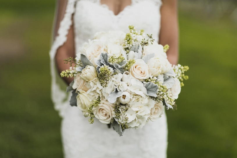 lush green and white florals for a wedding at the palm event center by heather elizabeth photography
