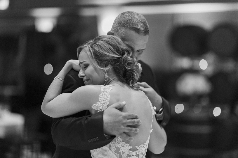 father daughter dance at a wedding reception at the palm event center by Heather Elizabeth Photography