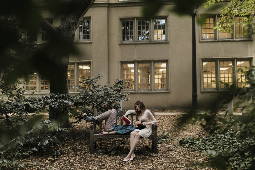 couple reading each other Harry potter for their engagement session in UC Berkley by Heather Elizabeth Photography
