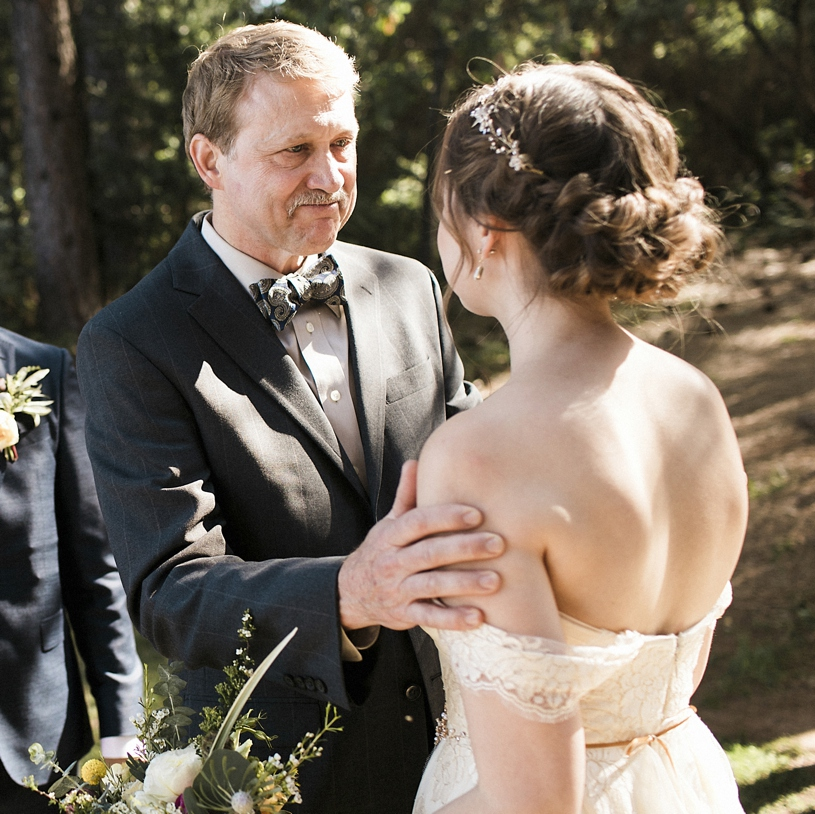 Emotional wedding photography of father giving his daughter away at a ceremony at the Forest House Lodge by Heather elizabeth Photography